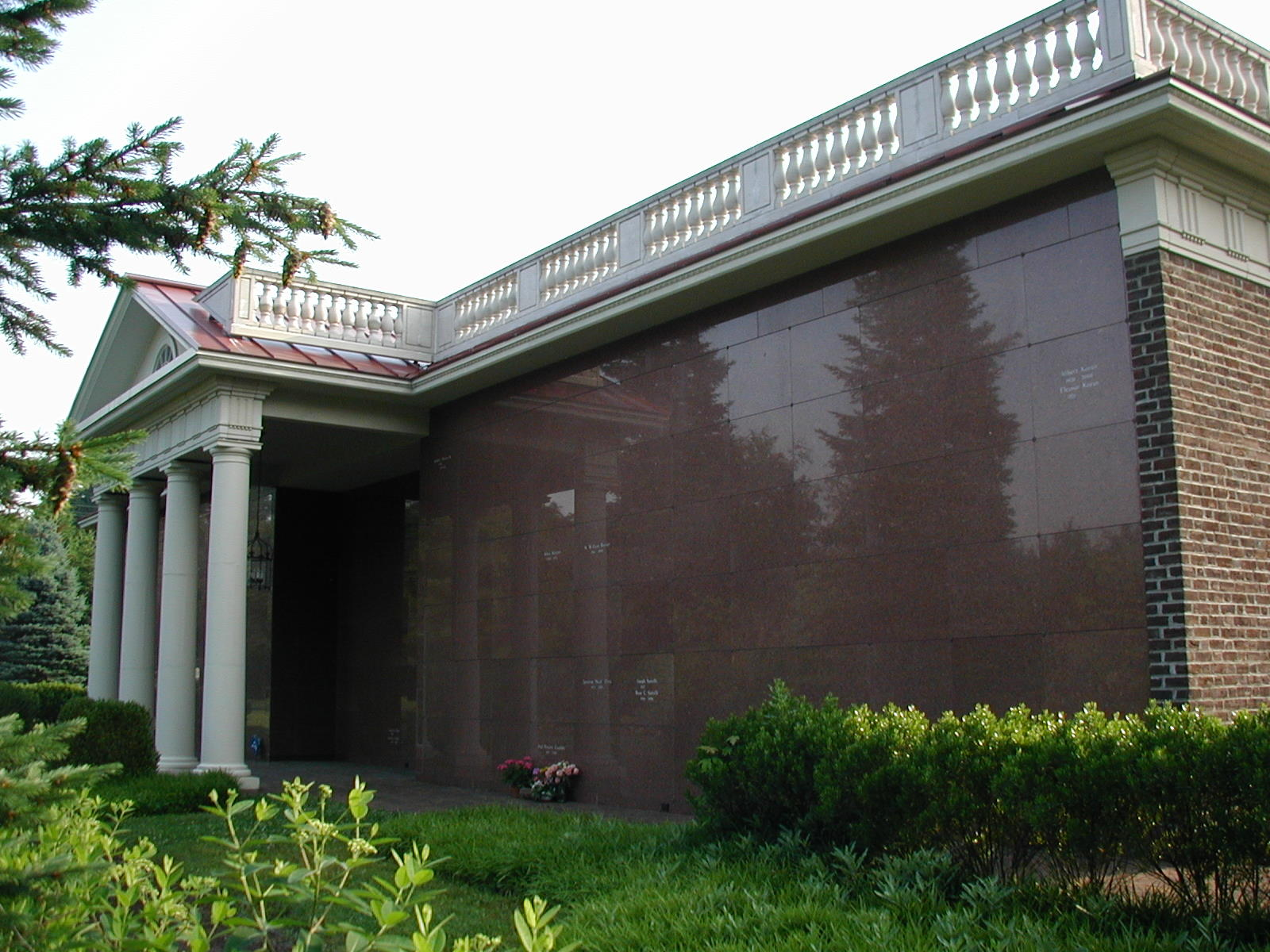 image of exterior crypts at Arlington Cemetery, a brick building with tall, white columns in front.