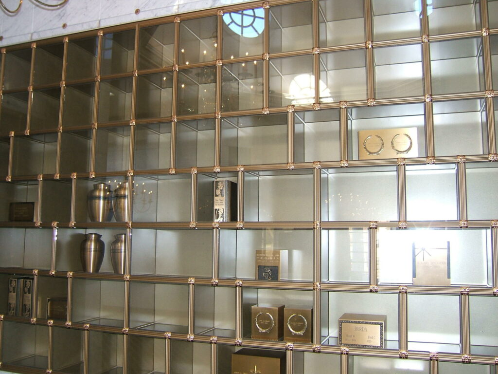 image of cremation niches, a wall of small glass front boxes with gold trim